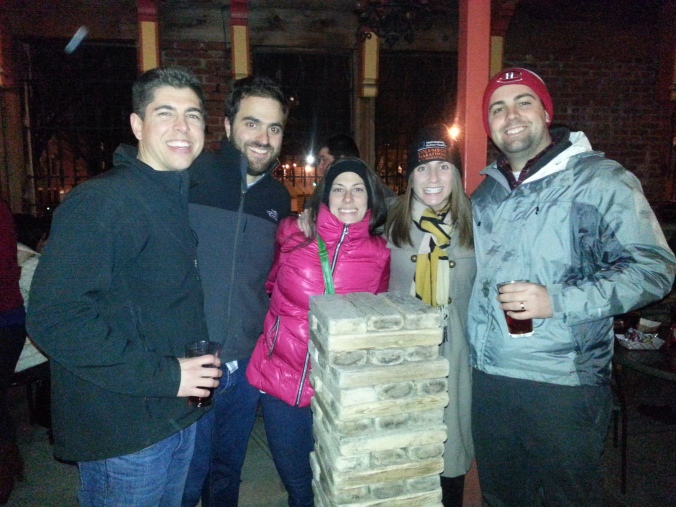 group in front of Giant Jenga