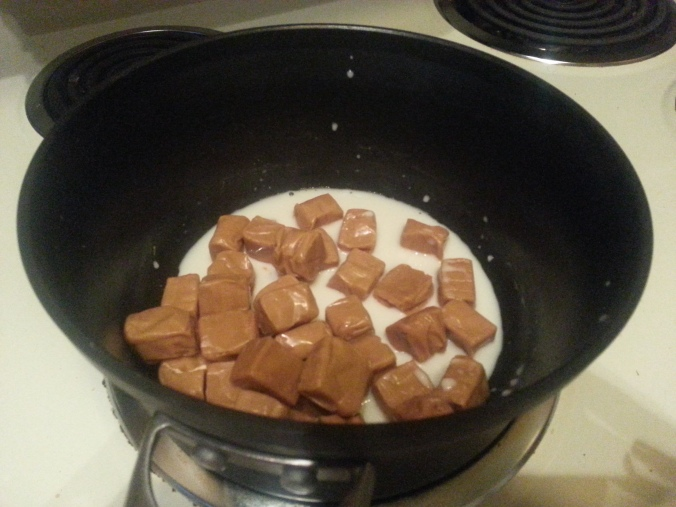 heating the caramel with almond milk