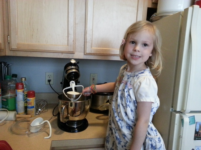 Posing before pouring the sugar for the cookies