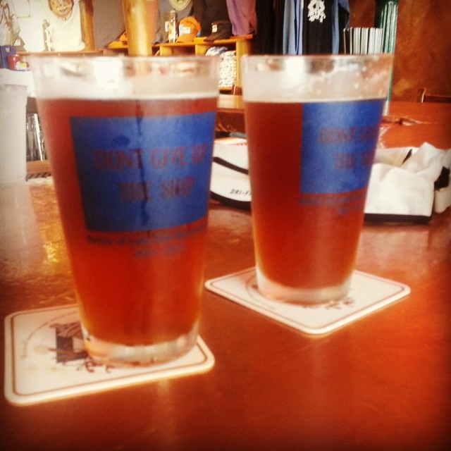 """Our beers from the brewery. Kinda blurry/misty but the glasses say """"Don't Give Up The Ship"""" which is on flags all over the island, just like the flag Commodore Perry hung on his ship!"""