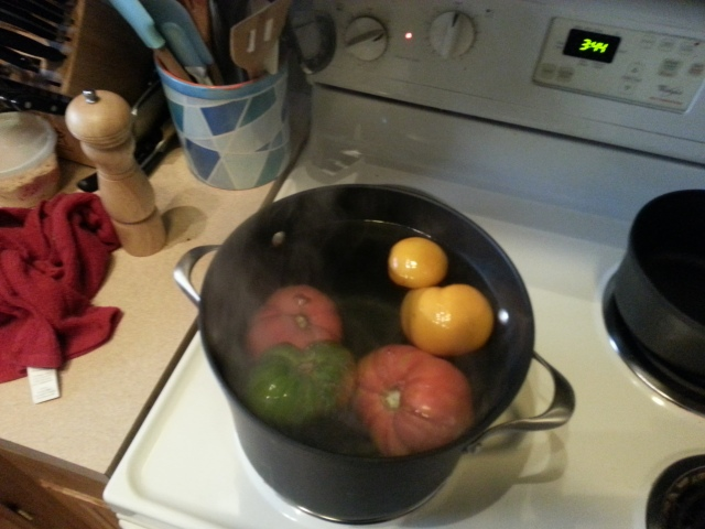 prepping tomatoes for homemade sauce
