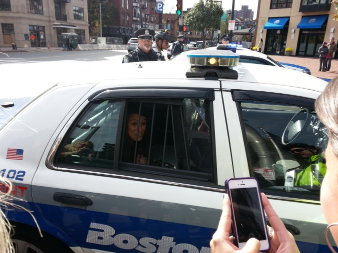 Busted! Melgar in a cop car.