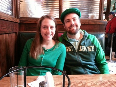 Decked out in green and awaiting our pizza. Doesn't the race sweatshirt that B's wearing look awesome?