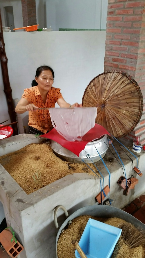 watching a woman make rice paper