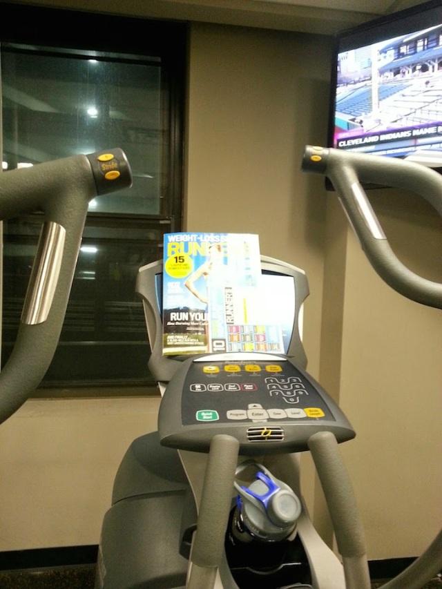 My elliptical set up. Phone, check. Water, check. Magazine, check. TV, check.