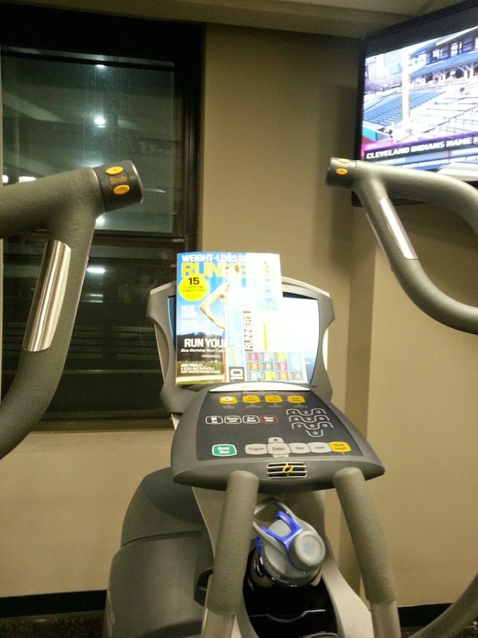 My elliptical set up. Phone, check. Water, check. Magazine, check. TV, check.