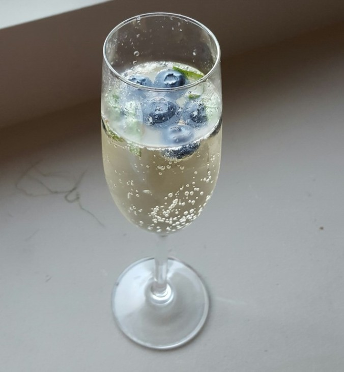 pre-dinner bubbly drink - limoncello, champagne, blueberries and basil