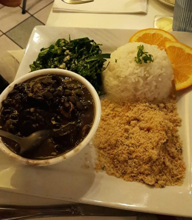 awful picture but amazing food- feijoada and farofa